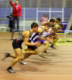 Boys run on the start. Unidentified boys of the start of the 60 meters dash on the Ukrainian Cup in Athletics on January 27, 2012 in Zaporizhia, Ukraine Royalty Free Stock Image