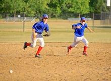 Boys Running for the Ball Stock Photos