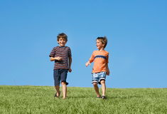 Boys Running Down A Hill royalty free stock images