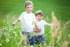 Boys running  through field Royalty Free Stock Photo