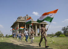 Boys running with indian flag. Boys and girls are running with indian flag and beautiful sunny day Stock Photography