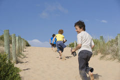 Boys Running On Sand Royalty Free Stock Image