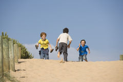 Boys Running On Sand Royalty Free Stock Image
