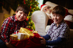 Boys with sack of presents Stock Photography