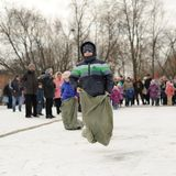 Boys sack-racing during winter Maslenitsa carnival in Russia Royalty Free Stock Image