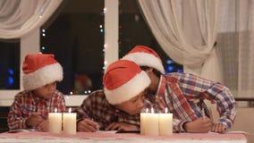 Boys in Santa hats. stock footage