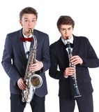 Boys with saxophone and clarinet Stock Images