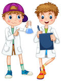 Boys in science gown writing and experimenting Stock Photos