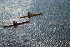 Boys sea kayaking. Royalty Free Stock Images