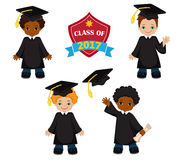 Boys. Set of children in a graduation gown and mortarboard. Royalty Free Stock Photography