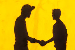 Boys Shadows Friends Hand Shake Royalty Free Stock Photography
