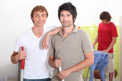 Boys sharing housework Royalty Free Stock Image