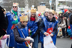 Boys sharing their candy on a carnival parade royalty free stock image