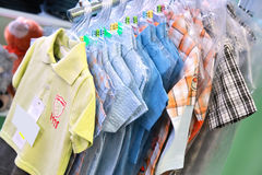 Boys' shirts in a shop Stock Photos
