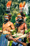 Boys at show in Papua New Guinea. Wabag, Papua New Guinea - circa August 2015: Native half-naked boys with colours on faces during traditional Enga cultural show Stock Photography