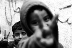 Boys are showing peace sign. At refugee camp in Betlehem Stock Photo