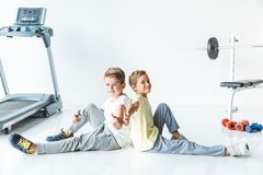 boys showing thumbs up in gym royalty free stock image
