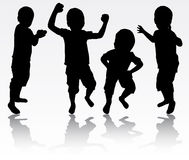Boys silhouettes. Happy boy dancing Stock Photography