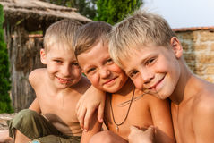 Boys sitting on a hay bale Stock Images