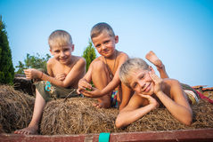 Boys sitting on a hay bale Royalty Free Stock Photos