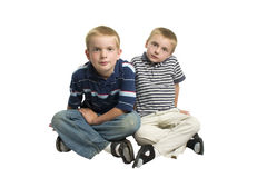 Boys sitting indian style Stock Photography