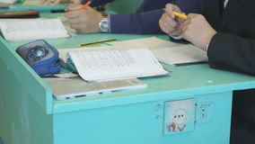 The boys sitting at the school desk indoors stock footage