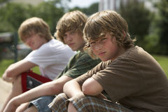 Boys Sitting On Street Curb Royalty Free Stock Photos