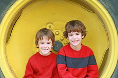 Boys Sitting in a Wheel Royalty Free Stock Image