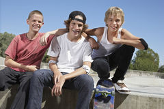 Boys With Skateboard Sitting Together In Skate Park Royalty Free Stock Photography