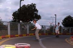 Boys skateboarding . Teenage boys on skateboards in the evening the park stock image