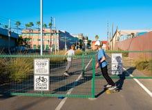 Boys Skateboarding On Los Angeles Metro Bike Path Stock Images