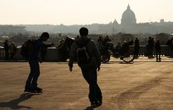 Boys skating in Rome. These two boys were skating in Rome on a nice spring evening royalty free stock photography
