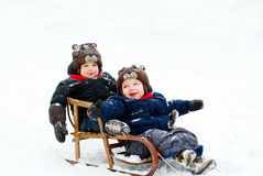 Boys in the sled Stock Photos
