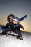 Boys on sled. Two happy boys on sled Royalty Free Stock Images