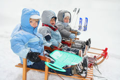 Boys on sled. Winter time - boys on sled stock photography
