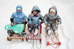 Boys on sled. Winter time - boys on sled royalty free stock photos