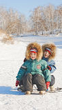 Boys Sledding Royalty Free Stock Photography