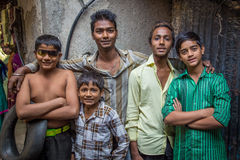 Boys from slum. MUMBAI, INDIA - 12 JANUARY 2015: Five Indian boys from Dharavi slum stand in street. Dharavi is one of the largest slums in the world Stock Images