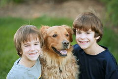 Boys Smiling with the Dog Royalty Free Stock Image
