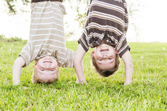 Boys smiling hanging upside-down Royalty Free Stock Images