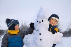 Boys with snow man Stock Image