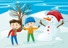 Boys and snowman in the snow field Royalty Free Stock Image