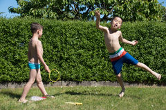 Boys with soap bubbles. In Summer Stock Photos