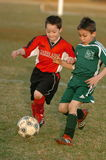 Boys Soccer Game Action. Teenage Boys battle for the soccer ball in game action Stock Images