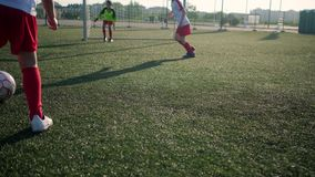 Boys soccer players are playing football and scoring goal. In training on stadium stock video