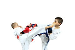 Boys in sporting overlays are training paired exercises karate Royalty Free Stock Images