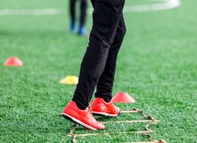 Boys in sportswear running on soccer field. Young footballers dribble . Training, active lifestyle, sport, children activity. Concept royalty free stock photography