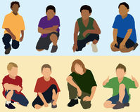 Boys squatting or kneeling. Eight boys squatting or kneeling down Royalty Free Stock Images