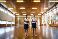 Boys standing with arms crossed in basketball court Royalty Free Stock Photos