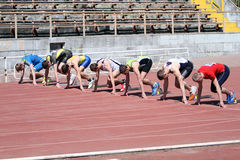Boys on the start of the 100 meters race Stock Photo